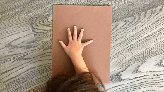 Place Hand on Paper