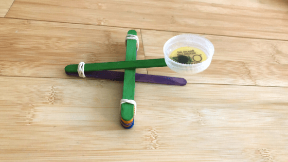 Popsicle Sticks Catapult with Rubber Bands and Bottle Cap