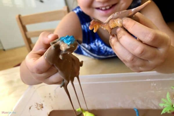 Chocolate Oobleck Dripping Dinosaur