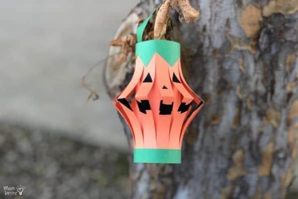 Pumpkin Lantern Hanging on Tree