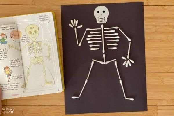 Day of the Dead Crafts and Activities for Kids featured by top Seattle lifestyle blogger, Marcie in Mommyland: QTip Skeleton with Book
