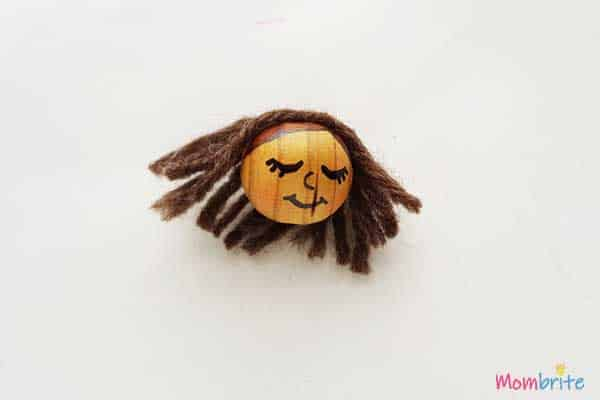 Pinecone Angel face draw on wooden bead