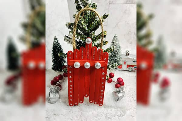 Red coloured Popsicle Sticks Christmas tree craft