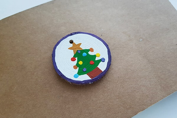 Round wood slice christmas tree designs fill with multiple Acrylic paints