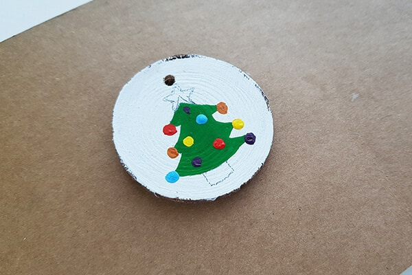 Round wood slice designs fill with multiple Acrylic paints