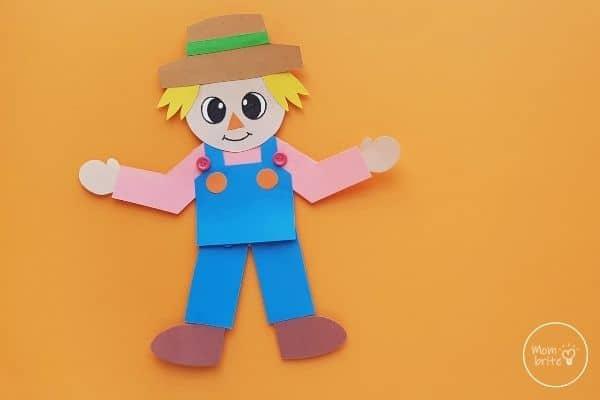 Paper Scarecrow Craft on Orange Background
