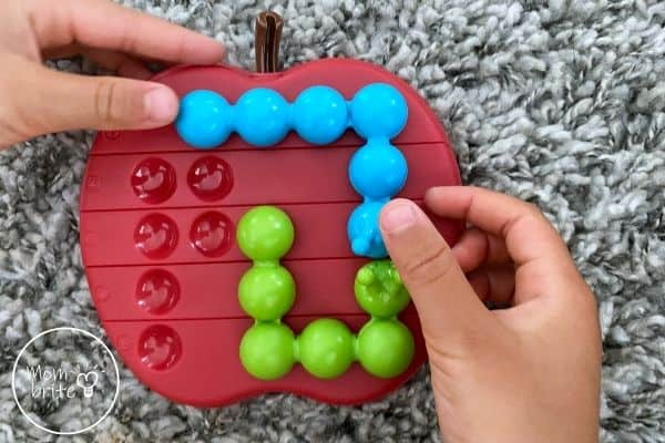 Apple Twist Review Playing a Puzzle