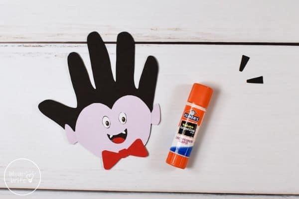 Vampire Handprint Craft Glue Eyes to Face