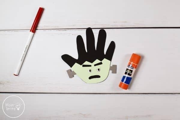 Frankenstein Handprint Craft Glue Eyebrows to Face