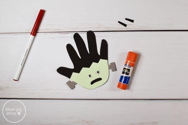 Frankenstein Handprint Craft Glue Eyelids to Face