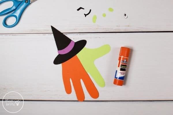 Witch Handprint Craft Glue Hat on Hands